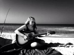 Playing music at Santa Rose Beach in Florida this summer.